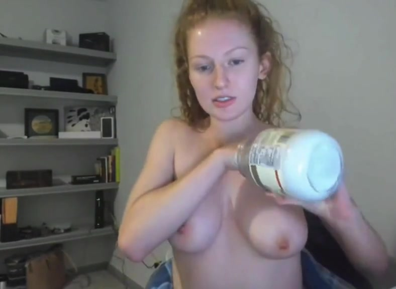 Young Redhead College Girl Topless