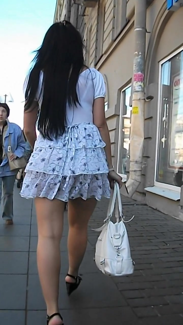 Charming Brunette With Sexy Butt In The Streets