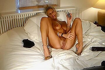 Oiled Up Blonde Fucks Her Dildos