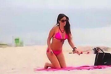 Hot college girl in thong bikini at the beach