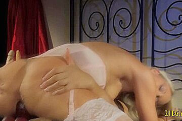 Two blonde angels having lesbian sex using a dildo