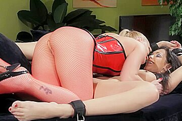 BDSM scene with two lusty lesbian devils