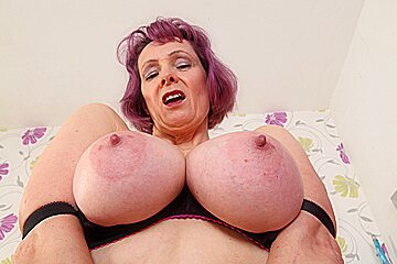 British gilf Tigger exposes her big tits and wet hole