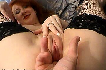 Redhead milf with wet pussy is fingered until climax