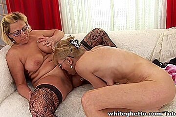 Lesbian grannies make out and play with dildos