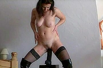 Hot latex porn video with sexy girl riding a huge dildo