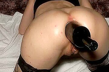 Stuffing one nice ass with a huge toy