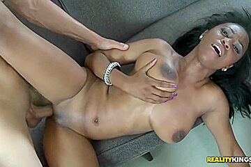 Black babe with luxurious natural big tits
