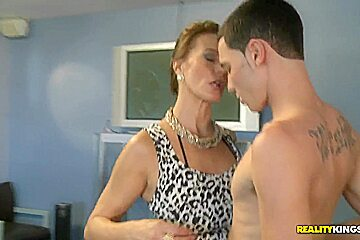 Mature woman blowing the cock of a young male
