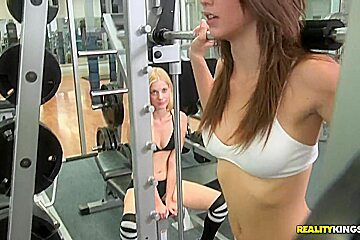 Lesbians Charlotte Stokely, Malena Morgan in the gym