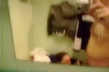 Pretty brunette girlfriend make a hell of a blowjob in men's changing room,damn