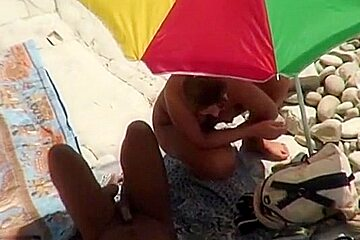 Voyeur tapes a couple having oral and cowgirl sex on a nude beach