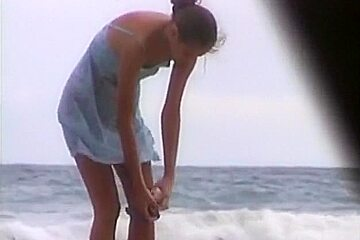 Voyeur tapes girls at a nude beach
