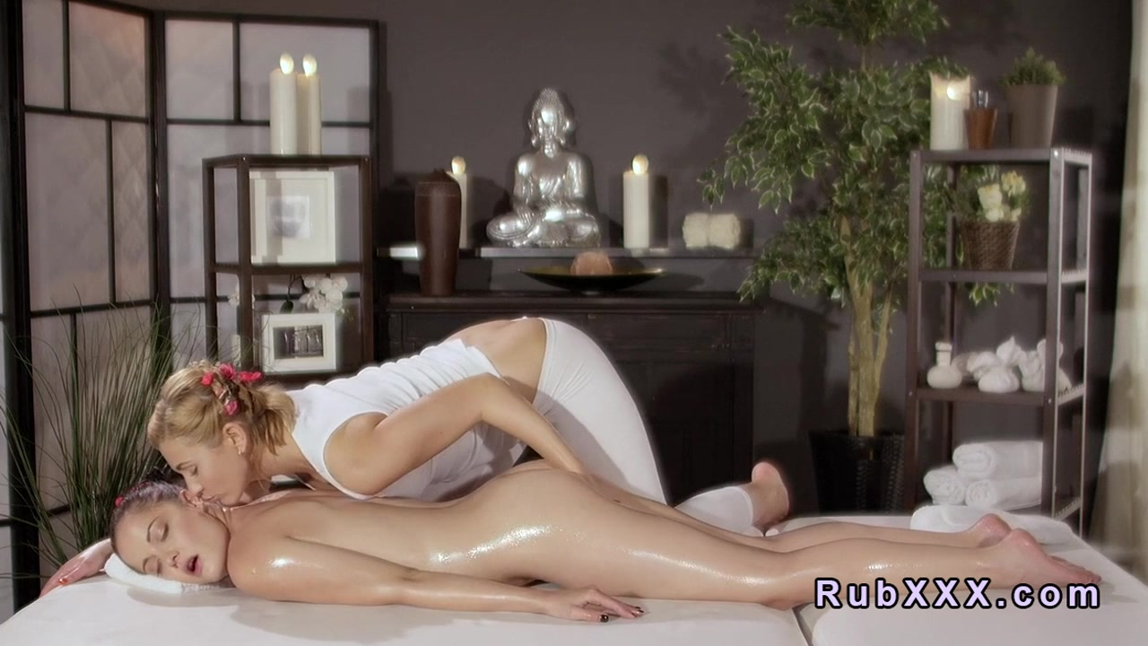 Blonde masseuse and brunette babe finger each other